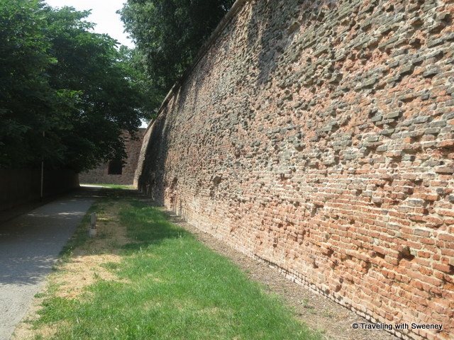 """Portion of the ancient walls adjacent to the bike path through a park in Ferrara, Italy"""