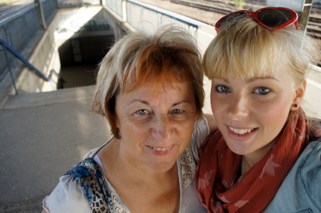 """Agness Walewinder traveling with mom at thetrain station in her hometown of Zagan"""