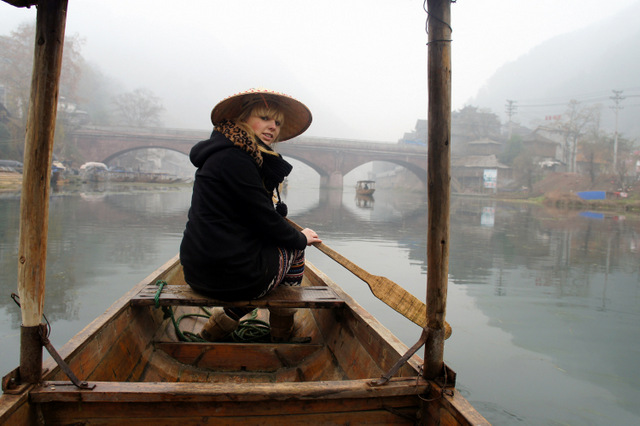 """On a rowboat in Fenghuang, Hunan, China"""