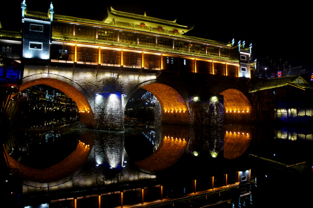 """Bridge and buildings of Fenghuang at night"""