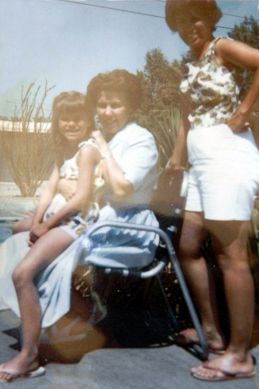 """""""Patti Maghamfar of One Road At A Time sitting on the lap of her aunt, her mother is standing behind them"""""""