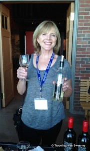 """Cathy Sweeney with a glass of Gaspereau Tidal Bay wine at a reception in Halifax, Nova Scotia"""