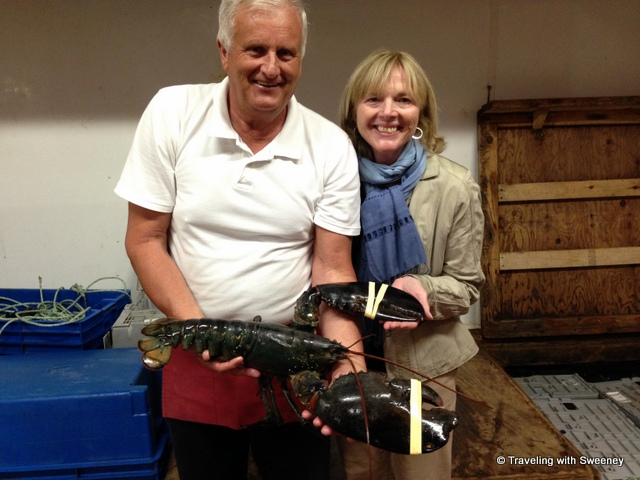 """""""Handling a huge live lobster at Hall's Harbour Lobster Pound, Nova Scotia"""""""