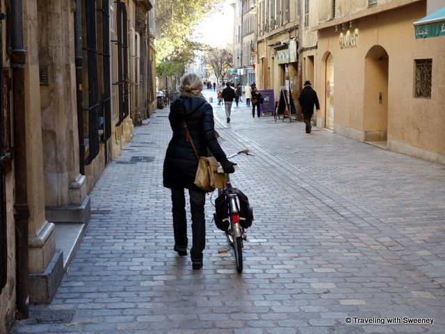 Woman and bicycle on a street in Aix-en-Provence