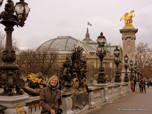 Sweeney in Paris on the Pont Alexandre III with the Grand Palais in the background