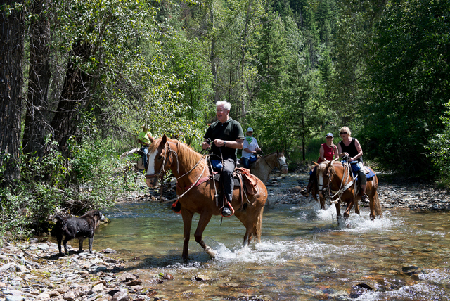 Mr TWS and Sweeney crossing the creek on horseback -- Photo Credit: Donnie Sexton