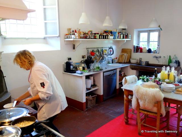 Alice happily at work preparing lunch in the sunny, spacious La Fattoria kitchen
