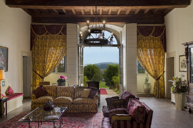 Elegant and warm -- the ground floor living room at Villa Buonvisi with a view of the estate's grounds