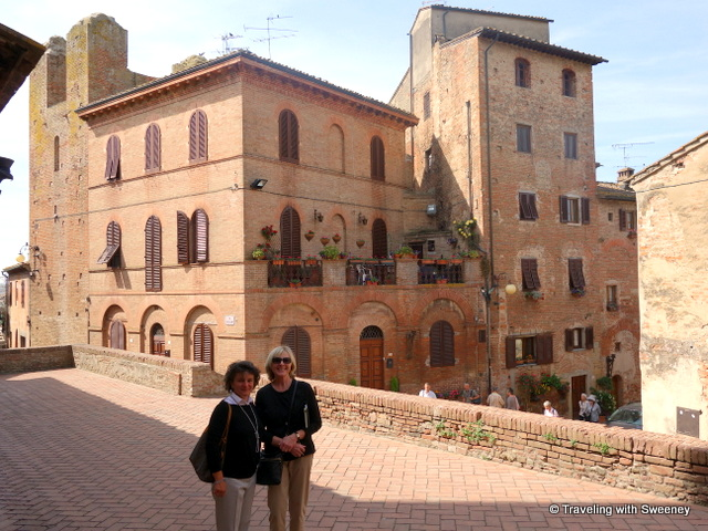 On the terrace of Palazzo Pretorio, typical Certaldo Alta buildings in the background