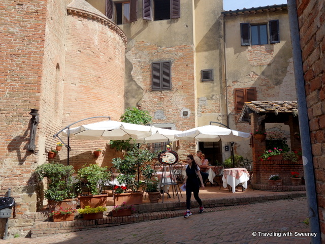 Restaurant and old buildings of Certaldo Alta, Italy