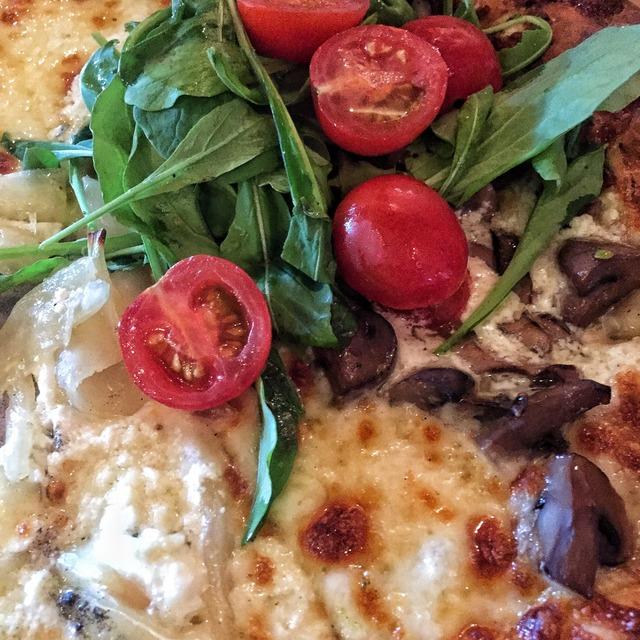 At Biga Pizza in Missoula, Montana -- mushroom & arugula pizza below (portabella and button mushrooms, herbed mascarpone, roasted garlic, mozzarella, fresh arugula, cherry tomatoes and herb oil)