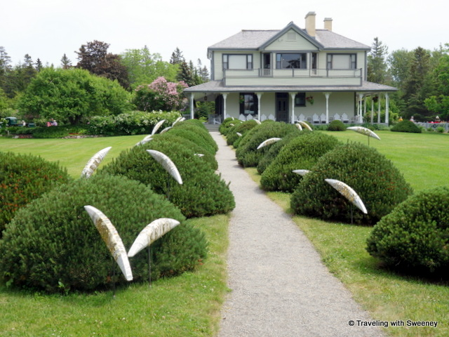 Along the path at Estevan Lodge at Reford Gardens, fish sculptures seem to jump over the bushes from the St. Lawrence River to the house.