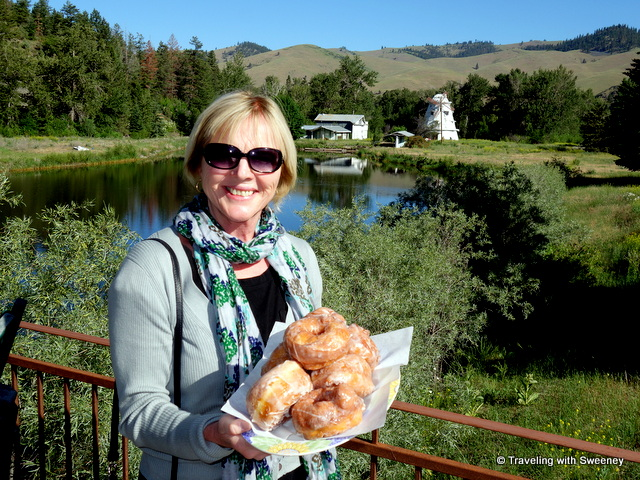 Holding a platter of huge doughnuts at Windmill Village Bakery in Ravalli, Montana