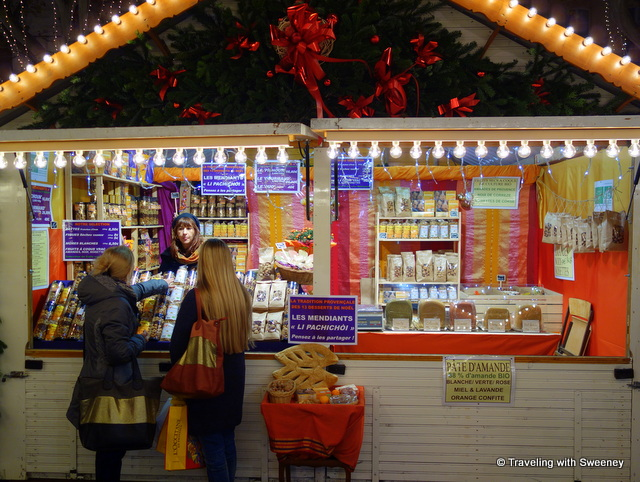 A vendor at the Christmas market in Avignon selling many items commonly included in the thirteen desserts