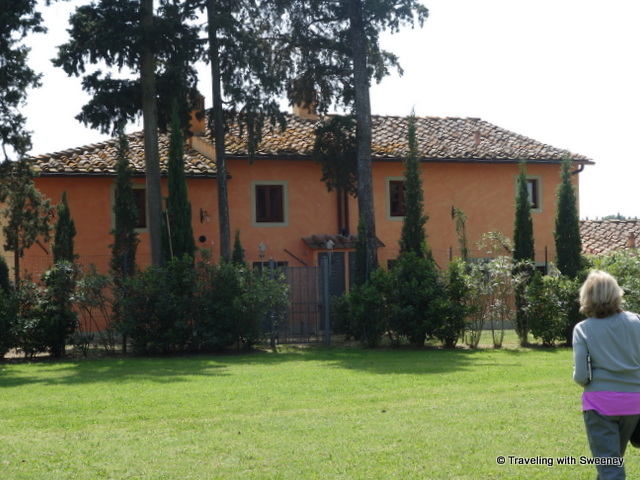 Crossing the wide expanse of lawn to the Borgorosa holiday rental buildings from Villa Caserotta