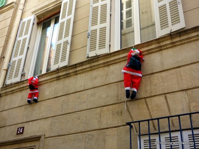 Santa Claus climbing the walls in Marseille, France