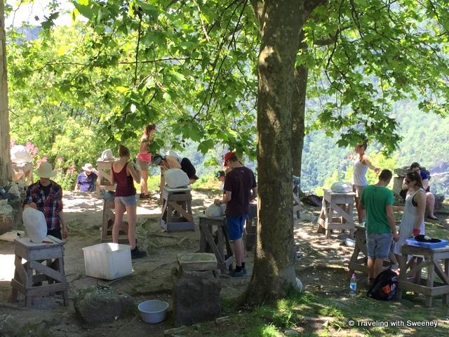 Students creating marble sculptures at an open-air art class near Pietrasanta, Italy