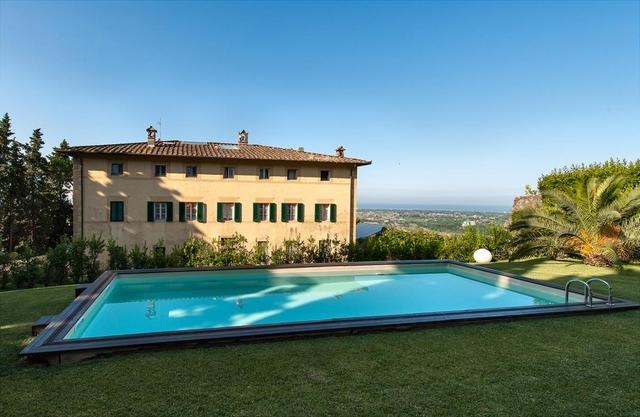 Inviting pool of Villa Sant'Andrea overlooking the Versilian coast of Tuscany