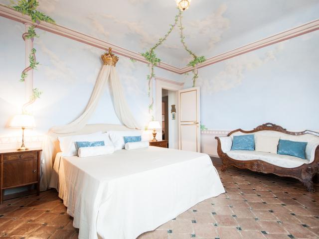 Frescoes adorn the walls of a bedroom in Villa Sant'Andrea