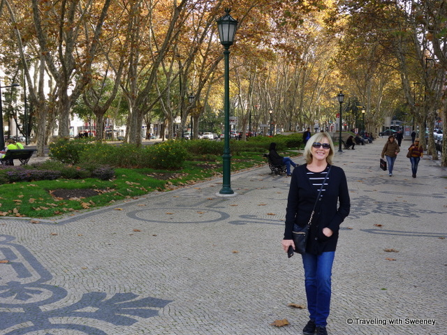 A walk on the tree-lined pedestrian walkway of the Avenida da Liberdade --- a Lisbon highlight