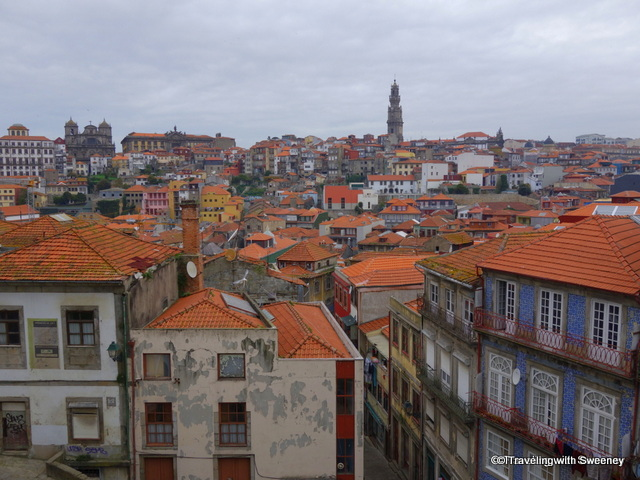 Over the rooftops of the colorful buildings of Porto, the tower of Clerigos Church is visible from many points in the city and surrounding area