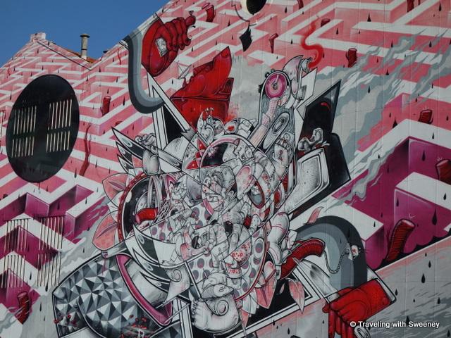 Street art on an industrial building along the waterfront, Lisbon