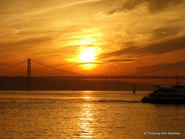 View of the sunset at Pont 25 de Abril from the Lisbon waterfront