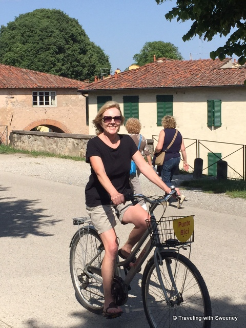 Biking on the ancient walls of Lucca while staying at Villa Buonvisi, a luxury holiday villa rental