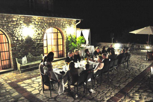 Friends and family dining al fresco at Borgorosa, a luxury rental villa in Tuscany