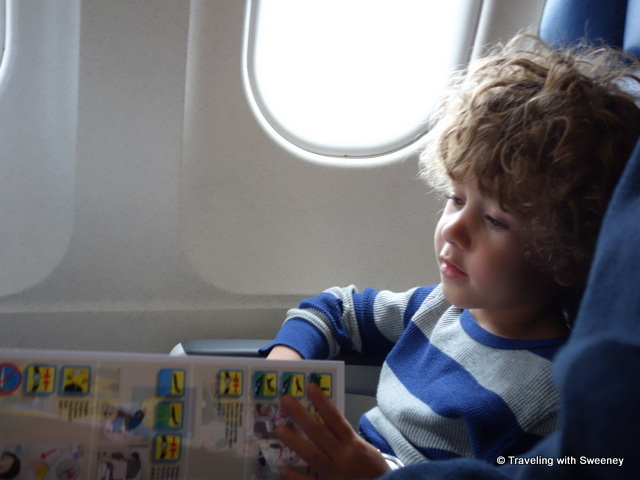 Reviewing the safety card and getting familiar with airplane features