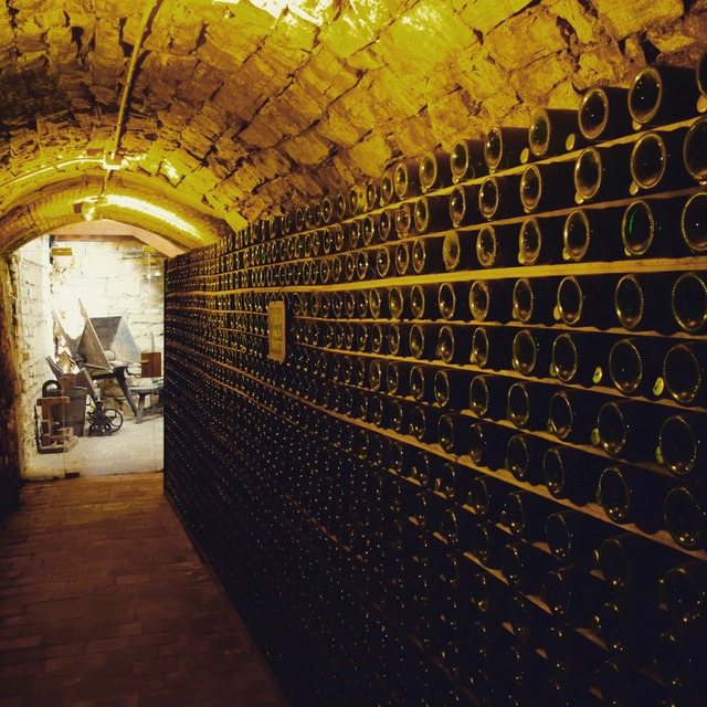 Walking through the tunnels beneath the Villa Sandi estate now used as wine cellars in Veneto region of Italy