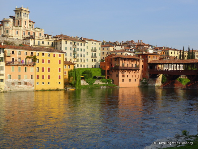 Ponte Vecchio and buildings of Bassano del Grappa -- liberty style architecture seen in pink building on the hill