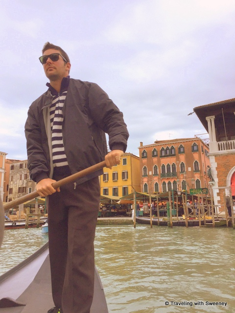 Our handsome gondolier takes us across the Grand Canal during our Walks of Italy Venice Food Tour