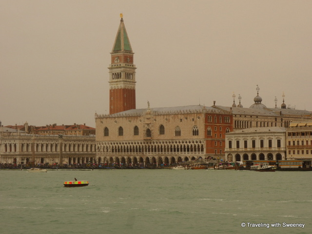 Arriving in Venice by boat as a light rain falls creating a surreal look of the city