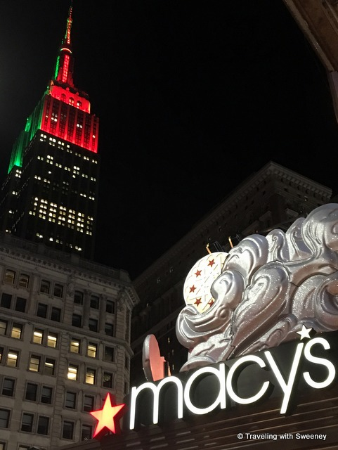 Red and green of the Empire State Building and Macy's on 34th Street epitomize Christmas in New York City