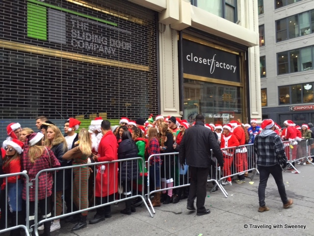 Ho Ho Ho! It's SantaCon! -- Revelers line up to get into 230 Fifth, a rooftop bar in New York City at Christmas