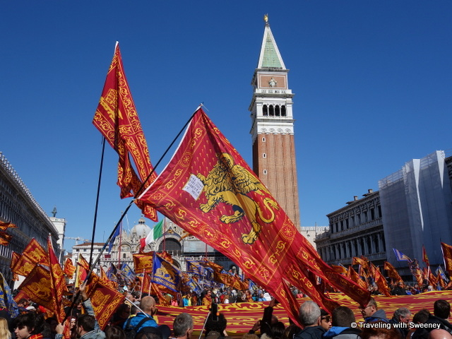 Venetian flags flying in St. Mark's Square on Liberation Day
