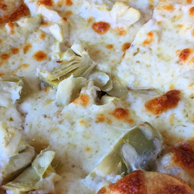 Garlic sauce and artichoke pizza at Transfer Pizzeria Café